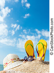 Summer beach vacation concept with flip flop, sunglasses and...