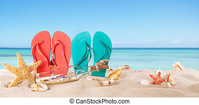 Summer beach with colored sandals