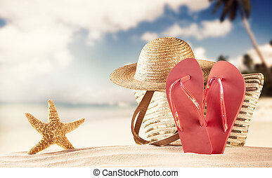 Summer beach with red sandals and shells