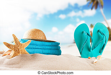 Summer beach with sandals and shells