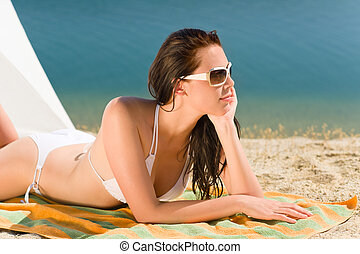 Summer beach young woman sunbathing in bikini - Summer beach...