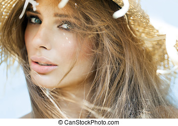 Summer Beauty - Young woman in straw hat in summer outdoors.