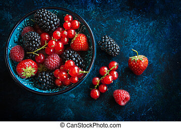 Summer berries in bowl on a table, fruits, raspberry, ...