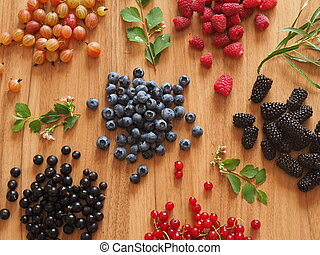 summer berries on a wooden table