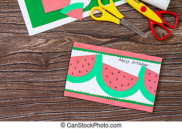 Summer birthday card with watermelons with birthday greetings. Handmade. Childrens creativity project, crafts for kids. Copy space.