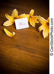 summer blooming flowers of yellow lily on a wooden