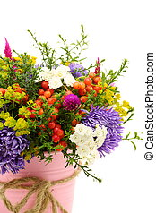 Summer bouquet of flowers and berries closeup.