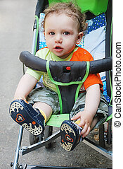 boy sitting in stroller