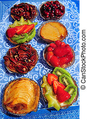Summer Cakes - Summer cakes with fresh and dry fruits on a...