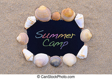 Summer Camp. - Blackboard on the beach with the phrase...