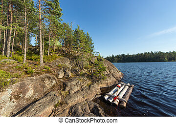 summer camp - tourist camp on the rocky shore of the lake