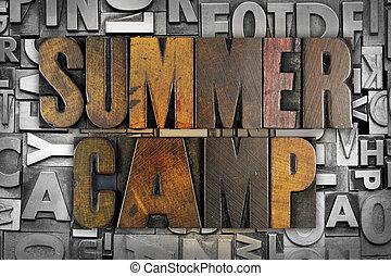 The words SUMMER CAMP written in vintage letterpress type