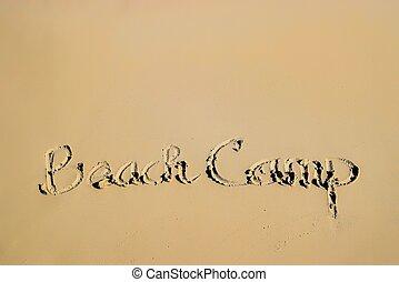 Summer camp written on sandy beach side