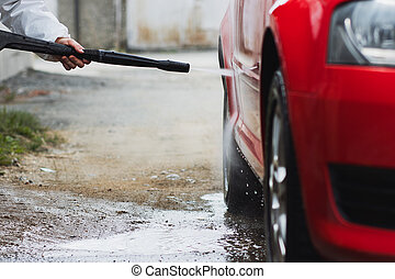 Summer Car Washing. Cleaning Car Using High Pressure Water