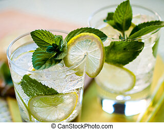 Summer cocktails - Two refreshing summer cocktails with lime...