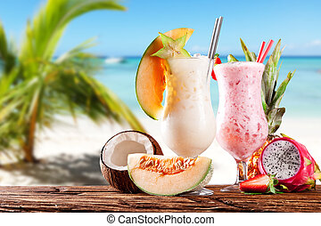 Summer cocktails with beach on background