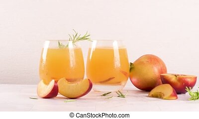 Summer cold drinks - Homemade peach juice with ice cubes and...