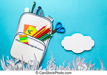 Summer concept, school backpack on graphic grass, made of...