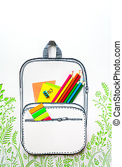 Summer concept, school backpack on green grass, made of...