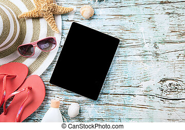 Summer concept with tablet and accessories - Top view of ...
