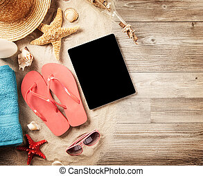 Summer concept with tablet and accessories - Top view of...