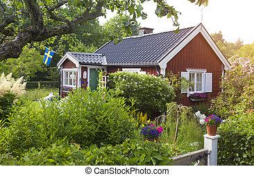 summer cottage with flower in the garden