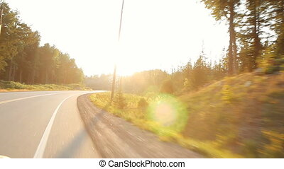 Summer country drive into sun. - haliburton, Ontario,...