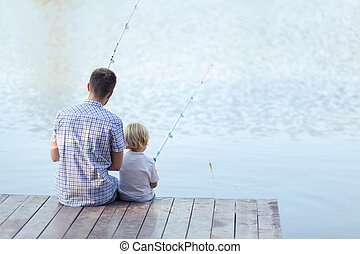 Summer - Dad and son fishing on a pier