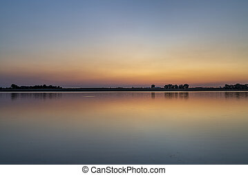 summer dawn over a calm lake