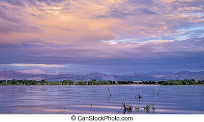 summer dawn over Boyd Lake and Front Range of Rocky Mountains