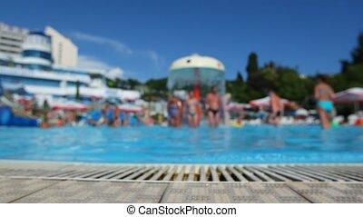 summer defocused background, people has fun in aquapark