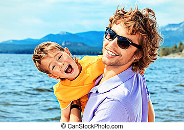 summer delight - Portrait of a happy father with his little...