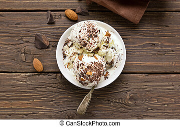 Scoops of vanilla chocolate ice cream with nuts