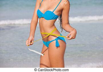 summer diet woman - slim summer diet woman with tape measure...