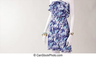 Summer dress in the wind. Breeze blowing on blue dress. Classic garment of light fabric. Feminine retro style clothing.