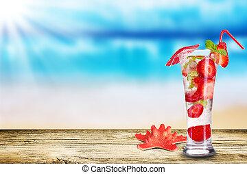 Summer drink - Fresh ice summer drink on beach background