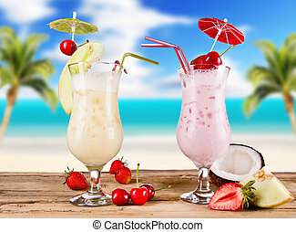 Pina colada drinks with blur beach on background