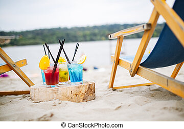 Summer drinks with blur beach on background. Vacation concept.