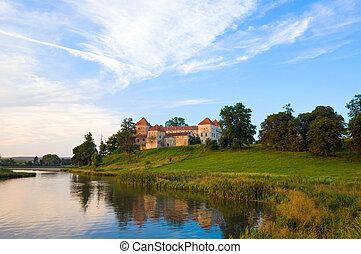 Summer evening view of Svirzh Castle (Lviv Oblast, Ukraine. Built in XV-XVII th century.)