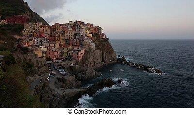 Summer evening twilight Manarola village , Cinque Terre -...