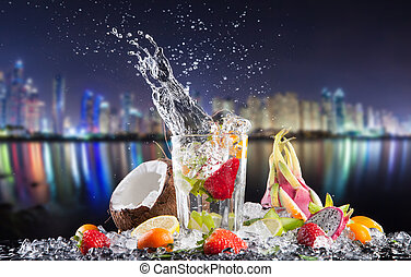 Summer exotic drinks with splash at night city - Summer ...