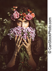 summer fairy - young beautiful woman portrait with flowers...