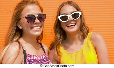 smiling teenage girls in sunglasses outdoors - summer...