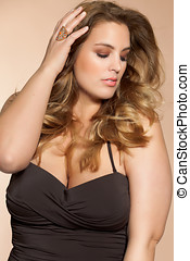 Beautiful plus size model wearing swimsuit.