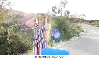 Summer fashion portrait pretty woman in the hat