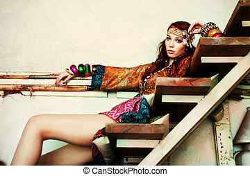 summer fashion - young woman in colorfull summer clothes sit...