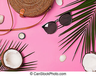 Feminine vacation accessories on the pink background, top view