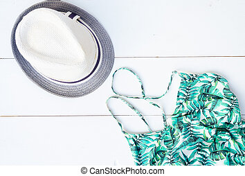 Summer flat lay scenery with swimsuit