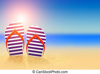 summer flip flops on the beach