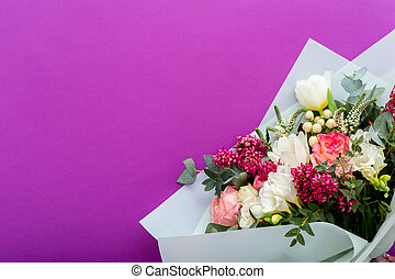 Summer flower bouquet on lilac purple background with place for text. Floristic roses, white tulips composition greeting card for women March 8, Mother Day, Valentine Day, Congratulations concept